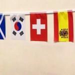 Изготовление гирлянд из флажков из ткани флажная лента на заказ печать флажков флажки стран РостАрт Москва 2018