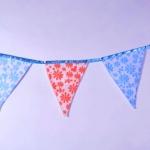 Изготовление флажной ленты из ткани на заказ гирлянда из флажков из ткани с тесьмой на заказ РостАрт Москва 2018 12014