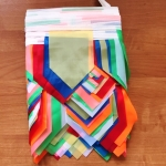 Изготовление гирлянд из флажков малого размера на заказ домик разноцветная флажная лента на заказ РостАрт Москва 2018 16829